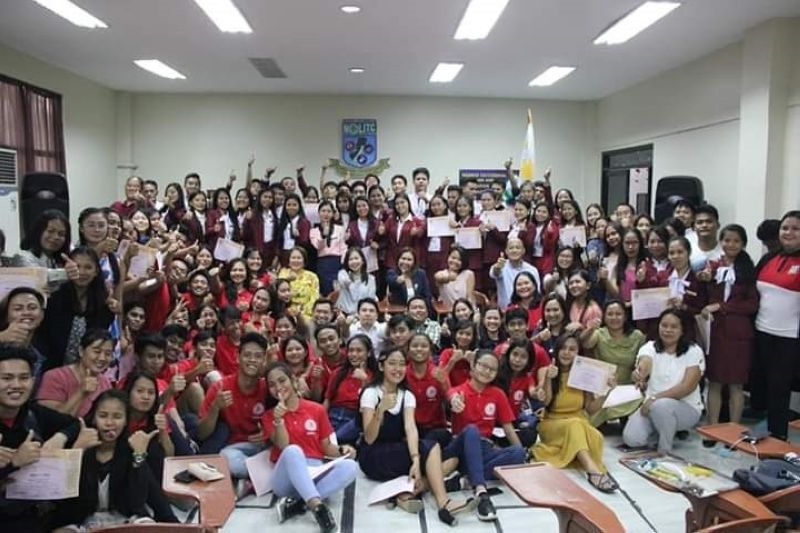 BACOLOD. NOLITC officials and representatives of industry partners with the graduates of Contact Center Services NC II training and Certified Professional Coder Course in rites held at the center in Bacolod City Friday. (Contributed photo)