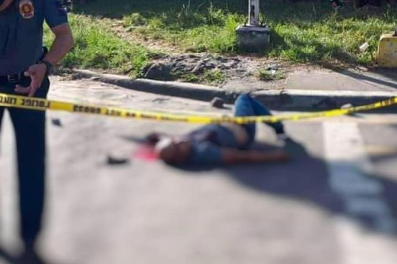 Police investigators secure the crime scene where a cop was shot dead by 4 unidentified assailants at corner Burgos-Circumferential Road, Barangay Villamonte, Bacolod City Saturday afternoon. (BCPO Photo)