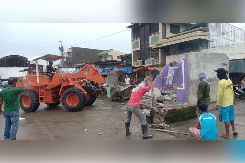 PAMPANGA. Local government personnel started demolishing the existing public market to give way for its reconstruction and improvement. (Contributed photo)