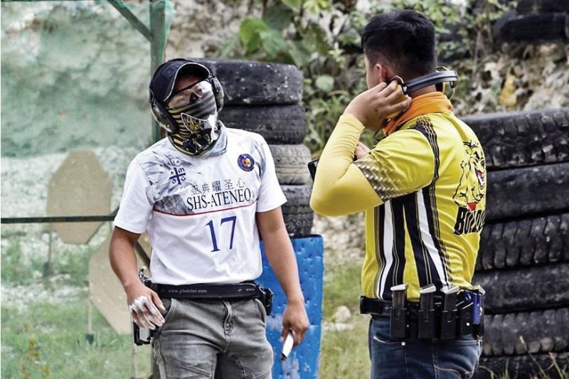 SECOND SPORT. Roygbiv Barro (left), a football varsity player, is also making waves in the field of practical shooting. (Contributed Photo)