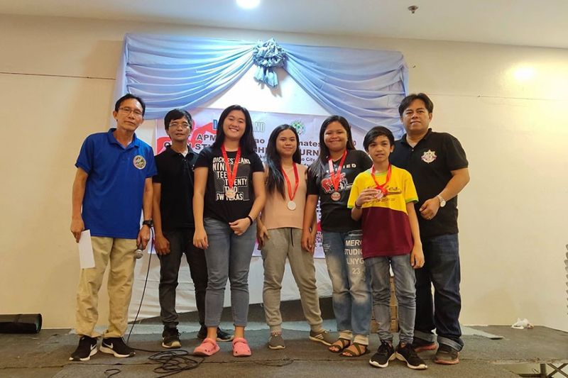 DAVAO. High school/college division winners of the recently-concluded APM Open Students Chess Tournament pose with organizers during the awarding ceremonies at Damosa Market Basket in Lanang, Davao City. (Ely Acas Facebook)