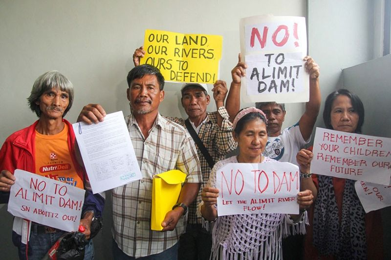 BAGUIO. Indigenous peoples (IP) from Ifugao hold placards outside the National Commission of Indigenous People (NCIP) office on Monday, February 17, 2020, after submitting a petition against SN Aboitiz proposed Alimit Hydro Power project. (Photo by Jean Nicole Cortes)
