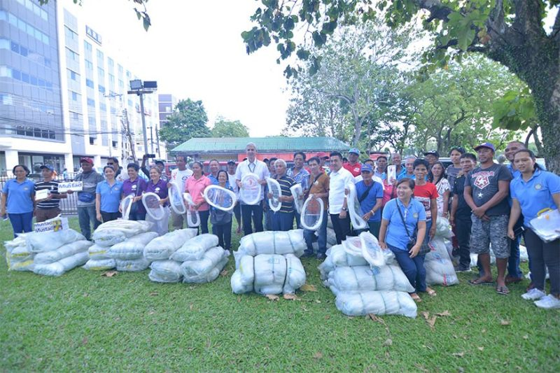BACOLOD. Governor Eugenio Jose Lacson and Third District Board Member Andrew Montelibano with the recipient-fisherfolk associations during the turnover of livelihood projects worth almost P2.3 million at the Provincial Capitol Ground in Bacolod City on Tuesday, February 18, 2020. (Contributed photo)