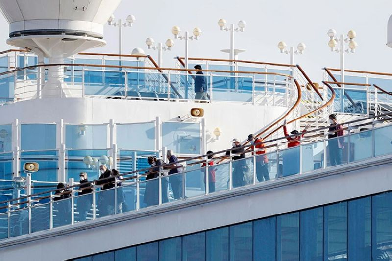 JAPAN. Passengers stand on the deck of the Diamond Princess cruise ship anchored at Yokohama Port in Yokohama, near Tokyo, Wednesday, February 12, 2020. (AP)