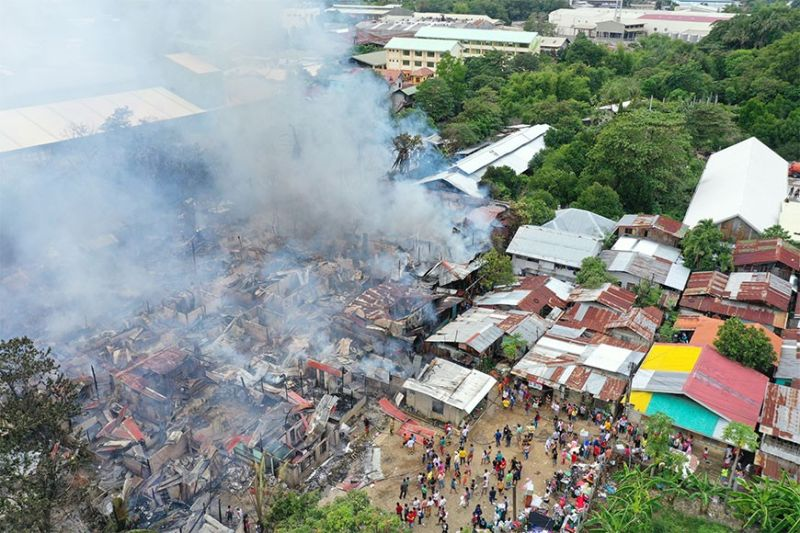 NO GOING BACK. Some fire victims cannot go back to where their houses stood in Sitio Paradise, Barangay Tabok, Mandaue City, as they are close to the Butuanon River. (SunStar File Photo)