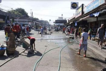 Bacolod Task Force conducts clearing operation at Burgos Public Market in Bacolod City in July last year. (Bacolod PIO file photo)