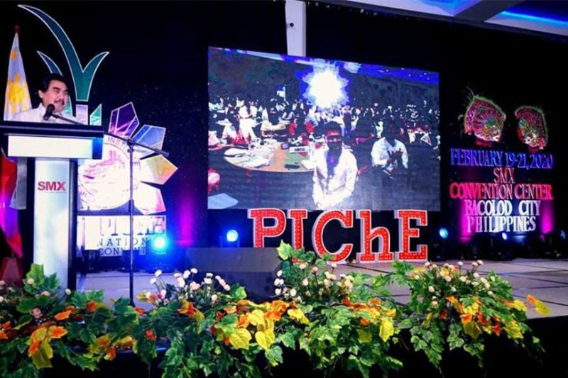 """BACOLOD. Bacolod City Mayor Evelio Leonardia delivers the welcome remarks at the opening ceremony of the 81st PIChE (Philippine Institute of Chemical Engineers) National Convention at SMX Convention Center Bacolod yesterday. The national convention that runs until February 22, is hosted by PIChE Negros Occidental Chapter. It is attended by about 1,200 Filipino chemical engineers around the country. Leonardia thanked the PIChE, headed by its president Maricris Vines, for holding their national convention in the """"City of Smiles,"""" saying, """"We have been in a state of high spirits except when the coronavirus came, it admittedly dampened our spirits a bit. But when we were told that PIChE is going to come, you are for us like a light in the darkness."""" (Contributed photo)"""