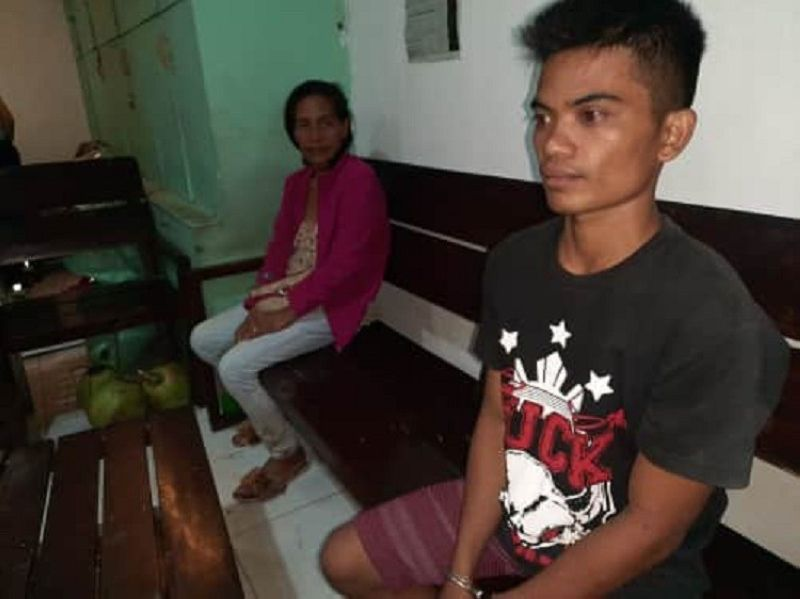 CEBU. Ariel Arriesgado Cuyos, a construction worker, was nabbed by members of the City Mobile Force Company after a warrant was served for his arrest for rape charges. (Photo by Arnold Bustamante)