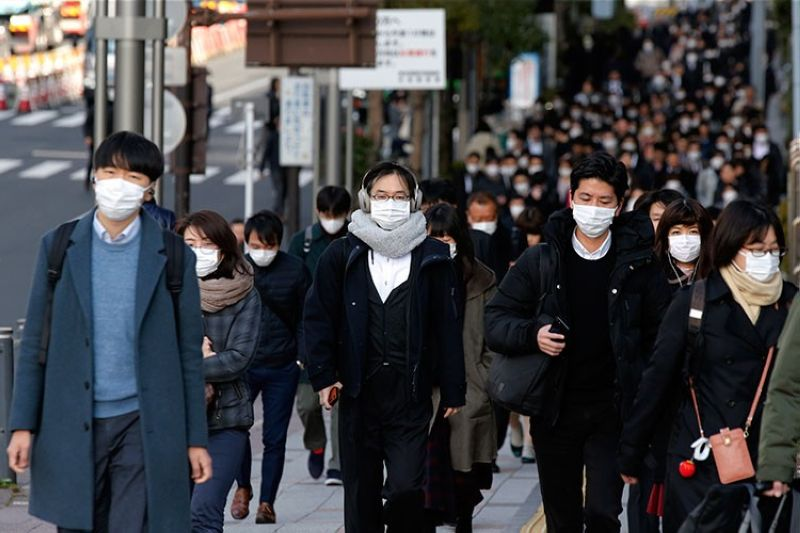 JAPAN. People wear masks as they commute during the morning rush hour Thursday, February 20, 2020, in Chuo district in Tokyo. A viral outbreak that began in China has infected more than 75,000 people globally. (AP)