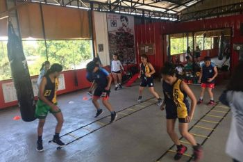 CAGAYAN DE ORO. Lady hoopsters of Cagayan de Oro are seen here flexing muscles off Red Corner Boxing and Fitness gym in the city. (Contributed photo)