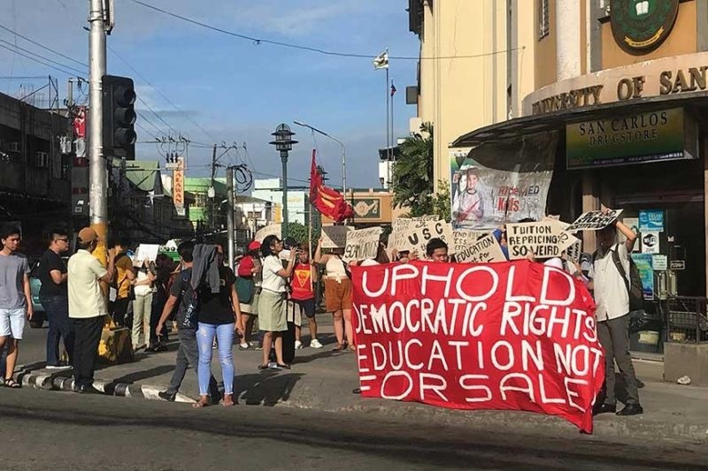 PROTEST. University of San Carlos students slam the impending tuition hike for the Law and Graduate Schools by staging a rally outside their downtown Cebu campus on Feb. 21, 2020. (SunStar Cebu /  Rebecah Roberts)