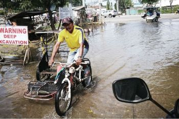 TRICYCLE BAN. Local government units will have to indicate in their tricycle route plan that the highways are off-limits to tricycles and similar modes of transportation. ( Allan Cuizon)