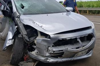 NEGROS OCCIDENTAL. Car hits a motorcycle parked at the side of the road along Kilometer 39 in Barangay Tortosa, Manapla town killing four people early morning on Friday, February 21. (Contributed photo)