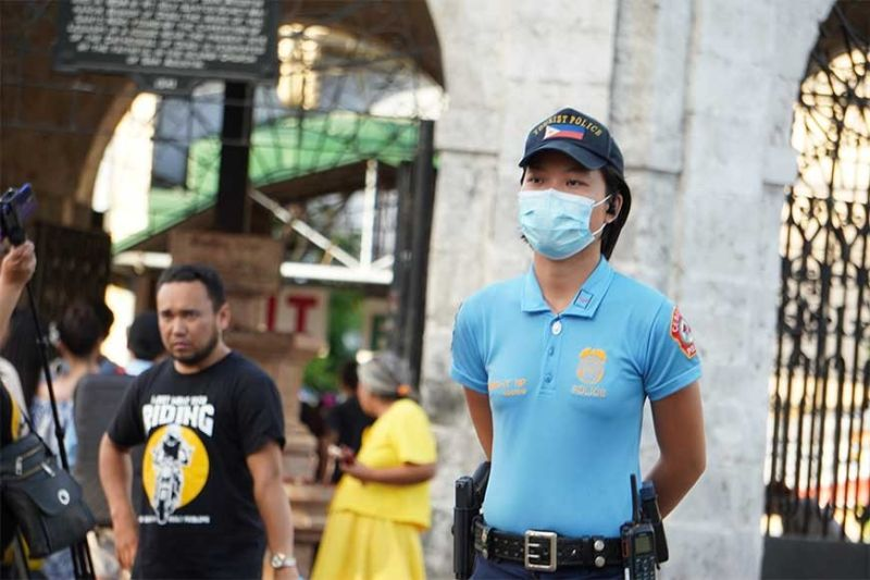 ON THE LOOK OUT FOR COVID-19. A face mask-wearing tourist police officer stands guard at the Magellan's Cross in downtown Cebu City to watch out for tourists visiting the heritage site. Earlier this week, authorities noted a drop of international tourist arrivals in Cebu due to the effects of the coronavirus disease 2019 (Covid-19) on international tourism. (SunStar Photo / Alex Badayos)