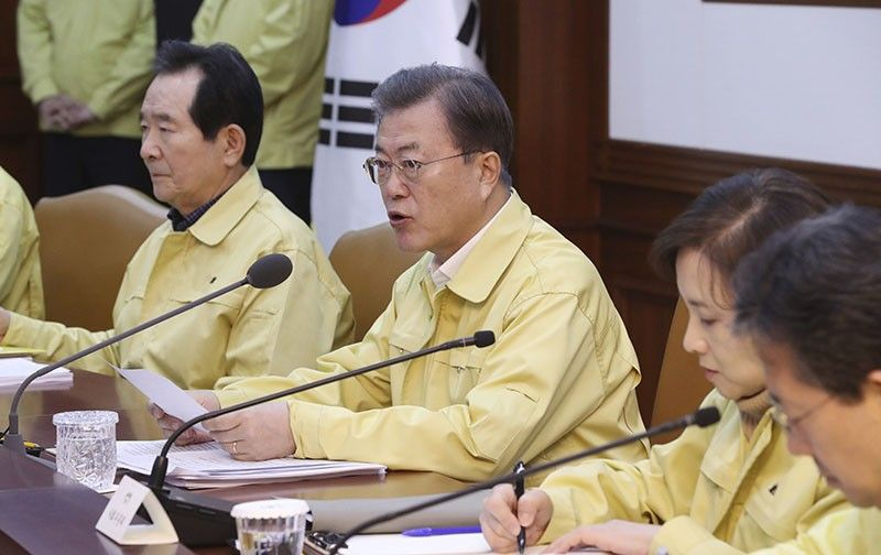 SEOUL, South Korea. South Korean President Moon Jae-in, center, speaks during a meeting at a government complex in downtown Seoul, South Korea, Sunday, February 23, 2020. South Korea's president has put the country on its highest alert for infectious diseases and says officials should take