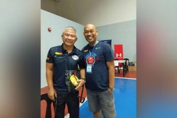 Albert Alocillo, seen here with former national team head coach Chot Reyes, is the new head coach of the Don Bosco Greywolves. / Contributed