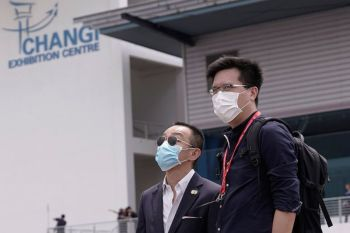 SINGAPORE. In this February 21 file photo, visitors wearing masks as a precaution against a new coronavirus arrive for the Singapore Airshow in Singapore. The virus becomes more widespread, trying to trace every contact would be futile, Singapore's Prime Minister Lee Hsien Loong acknowledged recently. (AP)