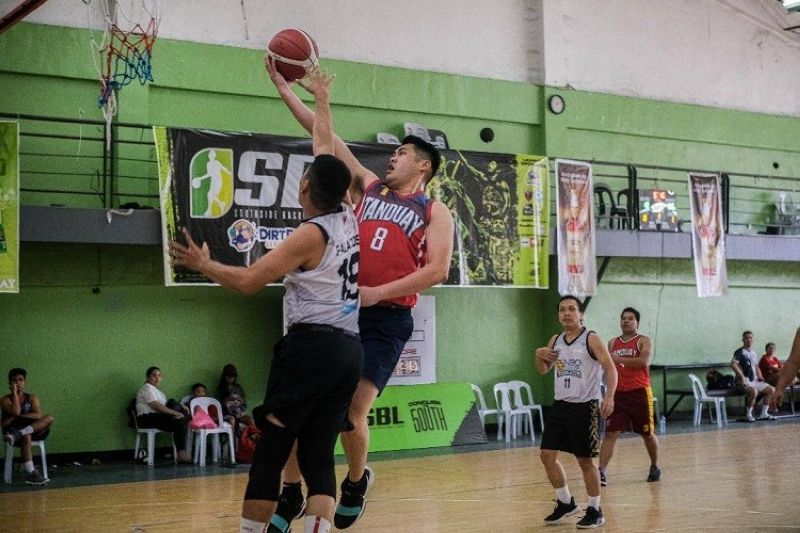 CEBU. A player from Tanduay Athletics tries to score on the defense of the Nepocenter Thurblazers. (Contributed photo)