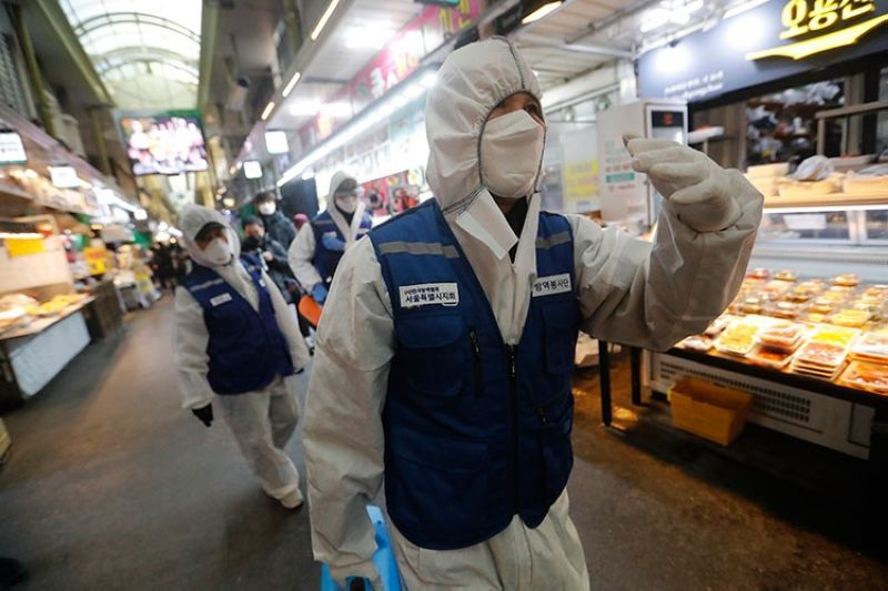 KOREA. Workers wearing protective gears arrive to spray disinfectant as a precaution against the coronavirus at a market in Seoul, South Korea, Monday, February 24, 2020. (AP)