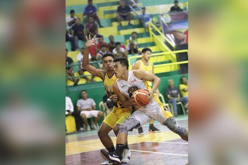 ASPA's Jiesel Tarrosa tries to escape the defense of KCS' Vincent Minguito in their semifinal game Mayor Edgardo C. Labella 1st Charter Cup Basketball Tournament on Monday night. (Amper Campaña)