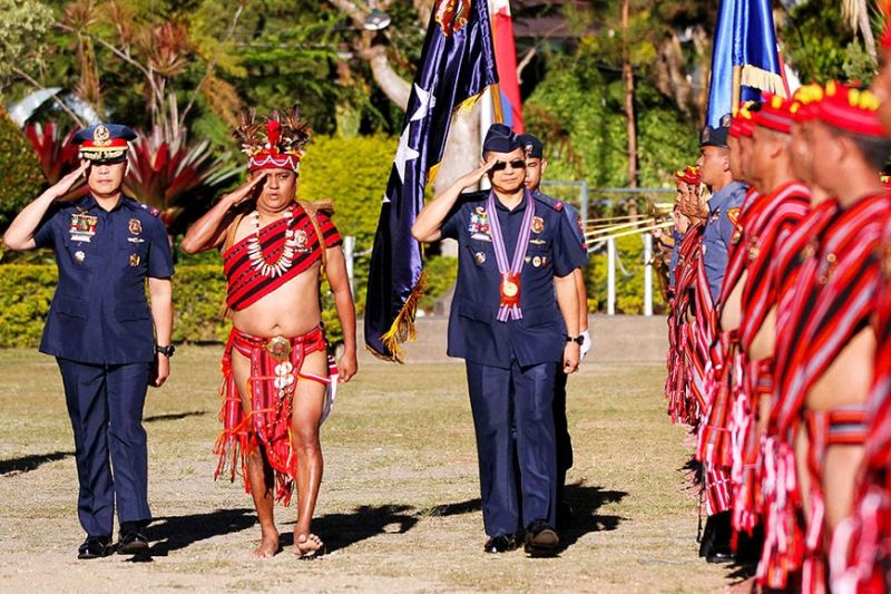 BAGUIO. Police Dir. Gen. Archie Gamboa is given arrival honors at Camp Bado Dangwa, in La Trinidad, Benguet by PRO-COR regional director R'win Pagkalinawan, and Police Colonel Noel Vallo (in native attire), regional deputy director for Logistics. (Photo by JJ Landingin)