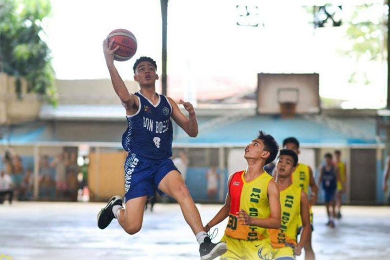 Don Bosco's Vincent Escobido glides to the rim for a lay-up. / Contributed
