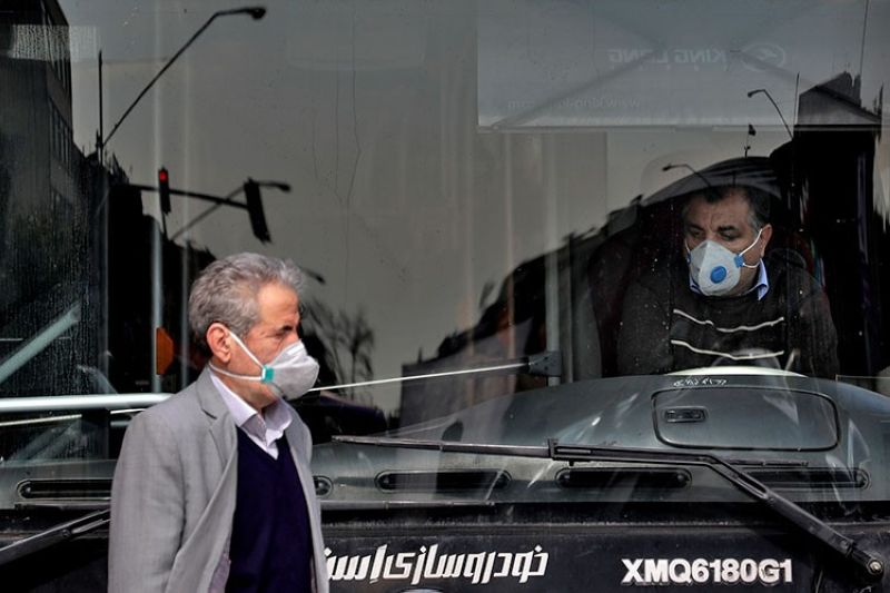 IRAN. A public bus driver (right) and a pedestrian wear masks to help guard against the coronavirus in downtown Tehran, Iran, Sunday, February 23, 2020. (AP)
