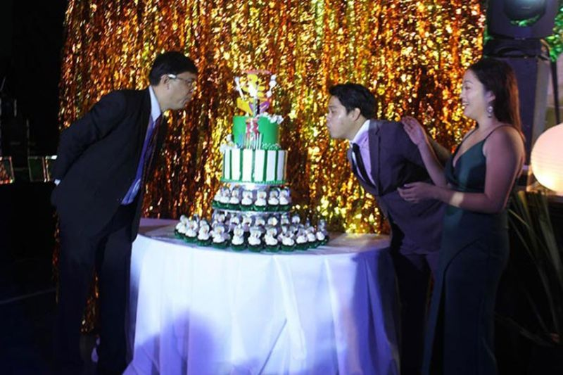 AKLAN. John Guidon Dela Cruz, company president, together with his son lead the ceremonial blowing of cake during the Bread and Butter's 35th year anniversary Monday night, February 24, 2020. (Photo by Jun N. Aguirre)