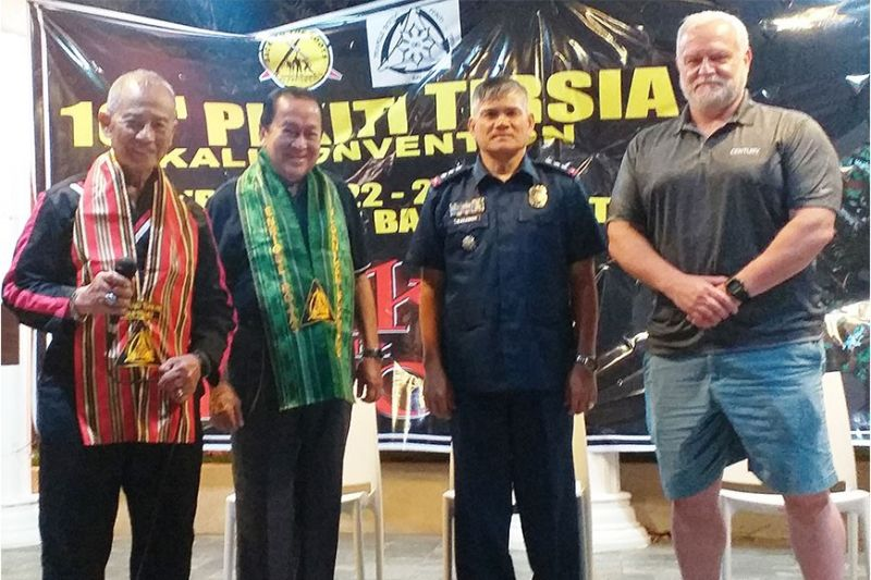 BACOLOD. Grand Tuhon Leo T. Gaje, Jr. (left) bestows the honorary title Baganihan Supremo (Supreme Hero) of Pekiti Tirsia Kali to Resorts Negrense owner and NFSP president Enrique D. Rojas (2nd from left). With them are NOPPO Director Col. Romeo Baleros and Las Vegas-based Martial Arts Supershow president Paul Webb. (Contributed photo)