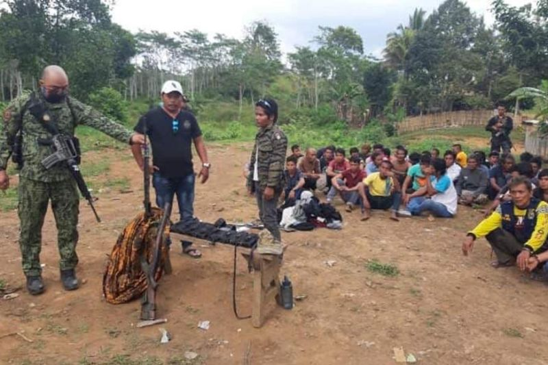 BUKIDNON. Police nabbed 40 suspected members of the Moro Islamic Liberation Front in Talakag, Bukidnon on Monday, February 24, where they recovered an M14 US rifle, fragmentation grenade, handheld radio and ammunition. (Photo courtesy of Bukidnon Police Provincial Office)
