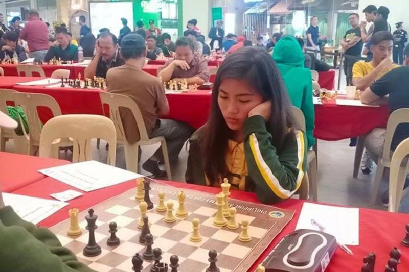 DAVAO. Samantha Umayan of Davao City (right) studies her next move in the recently-concluded 75th Philippine National Chess Championships NCR Elimination Leg that closed over the weekend at MET Live in Pasay City. (Contributed photo)