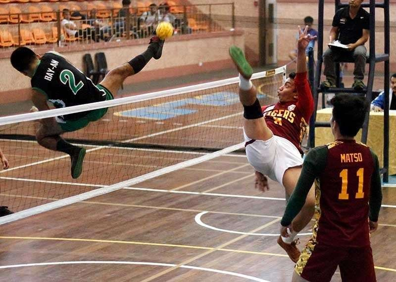 BAGUIO. In this photo taken in December 2018, sepak takraw players in the Baguio – Benguet Educational Athletic League seem to fly as they reach for the sepak and try to outpoint their opponent. (File Photo)