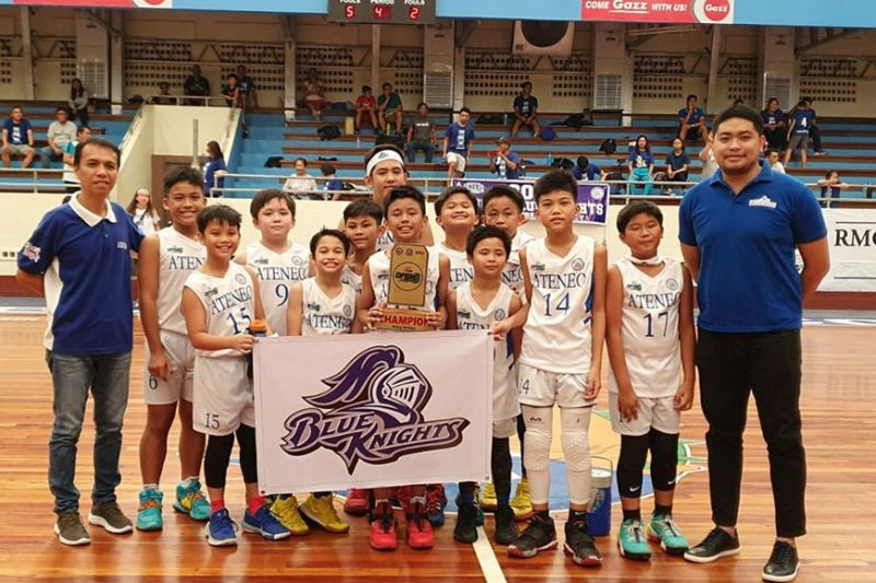 DAVAO. The Ateneo de Davao University players and coaches celebrate their Rising Division championship trophy in the recently-concluded Davao Pride Basketball League (DPBL) held at the Rizal Memorial Colleges (RMC) Petro Gazz Arena. (Photo by Jai Garcia)