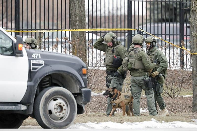 Police work outside the Molson Coors Brewing Co. campus in Milwaukee on Wednesday, Feb. 26, 2020, after reports of a possible shooting. <b>(AP Photo)</b>