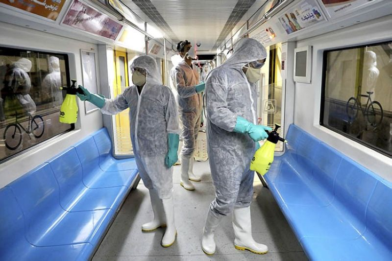Workers disinfect subway trains against coronavirus in Tehran, Iran, in the early morning of Wednesday, Feb. 26, 2020. Iran's government said Tuesday that more than a dozen people had died nationwide from the new coronavirus, rejecting claims of a much higher death toll of 50 by a lawmaker from the city of Qom that has been at the epicenter of the virus in the country. <b>(AP Photo)</b>