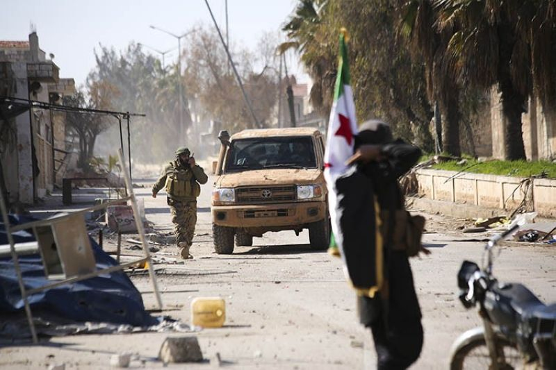 Turkish backed Syrian rebels enter the own of Saraqeb, in Idlib province, Syria, Thursday, Feb. 27, 2020. Turkey-backed Syrian opposition fighters Thursday retook a strategic northwestern town iof Saraqeb, opposition activists said, and cut off the key highway linking the capital, Damascus, with the northern city of Aleppo, days after the government reopened it for the first time since 2012. <b>(AP)</b>