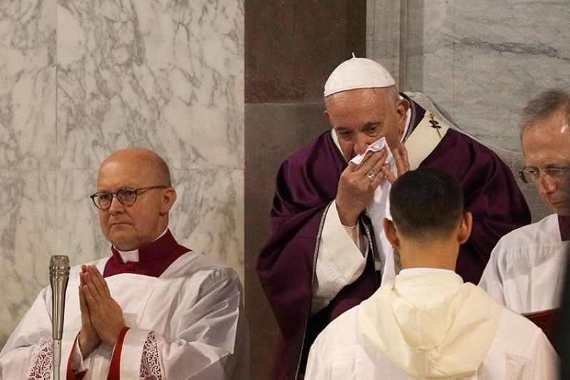 ITALY. In this picture taken Wednesday, February 26, 2020, Pope Francis wipes his nose during the Ash Wednesday Mass opening Lent, the 40-day period of abstinence and deprivation for Christians before Holy Week and Easter, inside the Basilica of Santa Sabina in Rome. (AP)