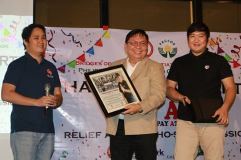 "PAMPANGA. Dr. Irineo ""Bong"" Alvaro, Jr., President of Bridges of Benevolent Initiative Foundation received a plaque of appreciation and memento from representatives of DM Prime Holdings Corp. and Tau Gamma Phi Fraternity during the recent thanksgiving party at Midori Hotel and Casino Clark. Alvaro led other companies and groups in the Tulong Agapay at Lingap (TAAL) relief and social mission. (Photo by Chris Navarro)"