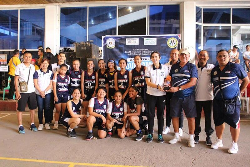 CAGAYAN DE ORO. The Corpus Christi Lady Knights with coach Catrina June Pong-Biongcog receiving the championship trophy after defeating the MOGCHS Lady Cavaliers, 48-38 in the LGU-Deped Developmental Grassroots basketball tournament in Cagayan de Oro City. (Contributed photo)