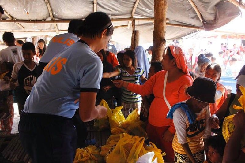 PAMPANGA. About 65 families have benefitted from the various government services offered through the Inter-agency expanded caravan. (Photo from PIA-Central Luzon)