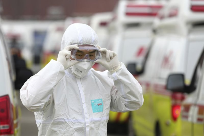 SOUTH KOREA. A health worker wearing a protective suit adjusts his goggles as he prepares to transport patients in Daegu, South Korea, Sunday, March 1, 2020. The coronavirus has claimed its first victim in the United States as the number of cases shot up in Iran, Italy and South Korea and the spreading outbreak shook the global economy. (AP)