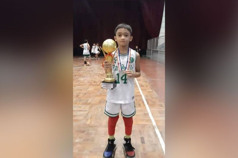 Little Wonderboy Ivan Mendoza, four-time Most Valuable Player (MVP), obtained in their four different basketball tournaments in just four months. Ivan also excels in academics. (Contributed Photo)