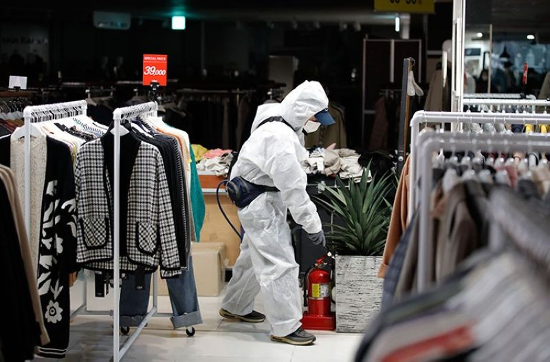 SOUTH KOREA. A worker wearing protective gear sprays disinfectant as a precaution against the new coronavirus at a department store in Seoul, South Korea, Monday, March 2, 2020. (AP)