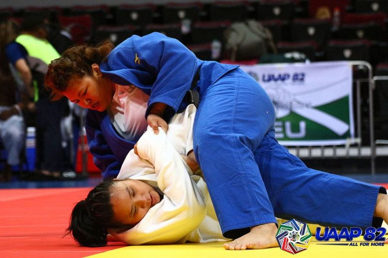 DAVAO. Dabawenya Sydney Sy Tancontian of the University of Santo Tomas (top) dominates her teammate Risa dela Cruz in their University Athletic Association of the Philippines (Uaap) Season 82 women's judo  78 kilograms division championship match at the Mall of Asia Arena Sunday, March 1, in Pasay City. (Photo from UAAP)