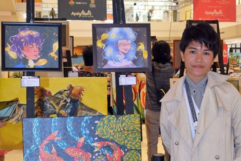 """Ariane Nicole Andrada with her digital artworks """"Scribbled Mind"""" and """"Galaxy for Quinni"""" were also sold on the same day. (Photo by Carla N. Cañet)"""