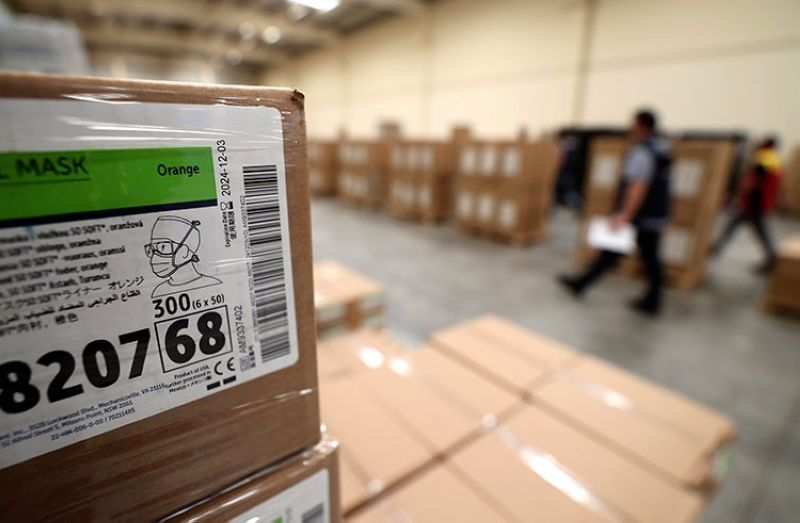 DUBAI. World Health Organization workers prepare coronavirus aid items to be shipped at a warehouse of the International Humanitarian City in Dubai, United Arab Emirates, Thursday, March 5, 2020. (AP)