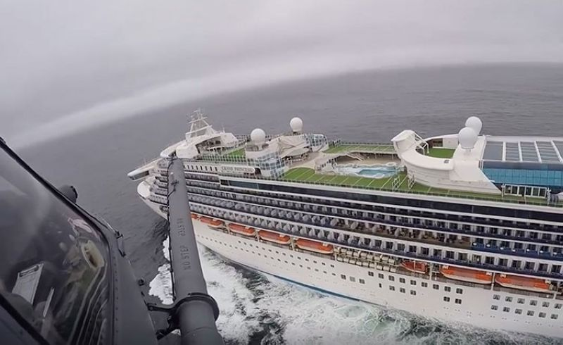 USA. In this image from video, provided by the California National Guard, a helicopter carrying airmen with the 129th Rescue Wing flies over the Grand Princess cruise ship off the coast of California Thursday, March 5, 2020. (AP)