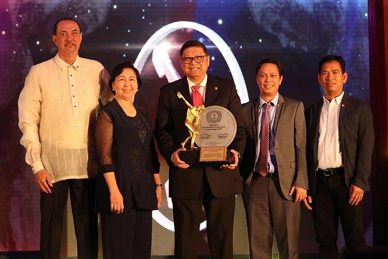 "MANILA. Southeast Asian Games Team Philippines chef-de-mission Philippine Sports Commission (PSC) Chairman William "" Butch"" Ramirez, center, with the PSC Board of commissioners receive the collective Athlete of the Year Award for Team Philippines during the PSA Awards Night held Friday evening, March 6, at the Manila Hotel. (PSC photo)"