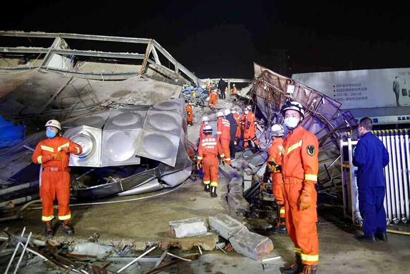 CHINA. Rescuers work at the site of a collapsed hotel building in Quanzhou city in southeast China's Fujian province Saturday, March 7, 2020. The hotel used for medical observation of people who had contact with coronavirus patients collapsed in southeastern China on Saturday, trapping dozens, state media reported. (Chinatopix Via AP)