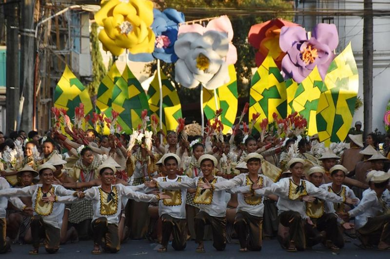 """Delegates from the different municipalities of Abra in their colorful """"abel"""" costumes perform during the street dancing competition of the 2020 Kawayan Festival at the major thoroughfares of Bangued, Abra. This is the first time that all of the 27 municipalities of Abra participated in the activities of the provincial festivity. (Photo by Redjie Melvic Cawis)"""